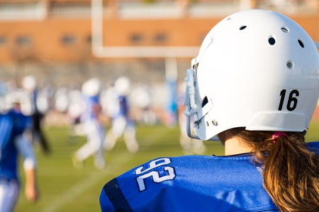 punter: View of a football game from the bench