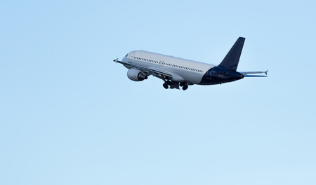 get away: Airplane taking off from the airport of Barcelona