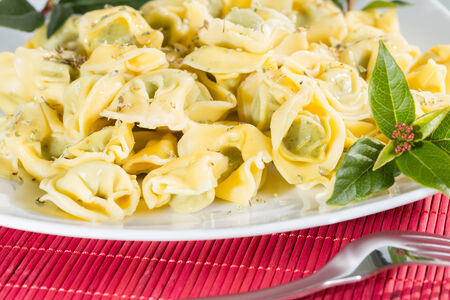 Delicious stuffed tortellini with spinach and a touch of oregano photo