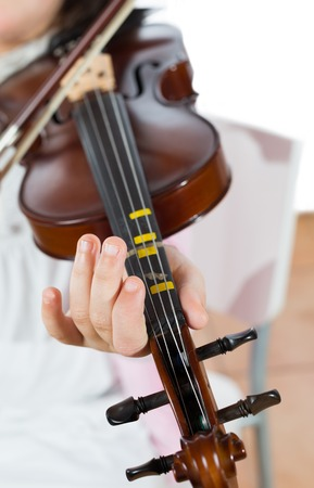 wench: Prodigy playing the violin in the school of music Stock Photo