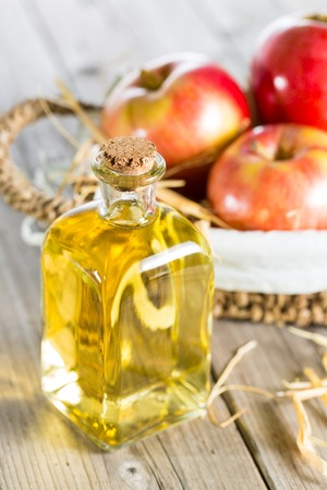 Homemade Vinegar galas apples on a table in a farmhouse Stock Photo - 26532602