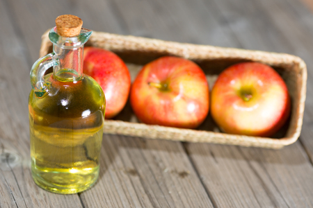 Homemade Vinegar galas apples on a table in a farmhouse Stock Photo - 26716033