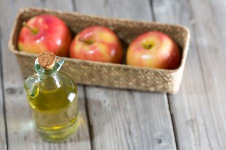 Homemade Vinegar galas apples on a table in a farmhouse Stock Photo - 26716036