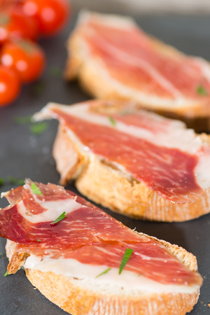 Skewer iberico ham with his bread with tomato photo
