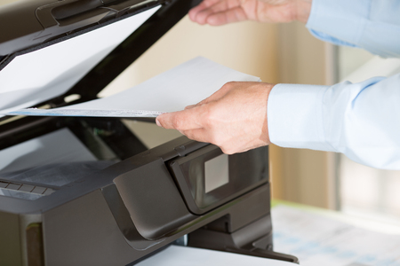 mfp: Performing a photocopy clerk with multifunction printer Stock Photo