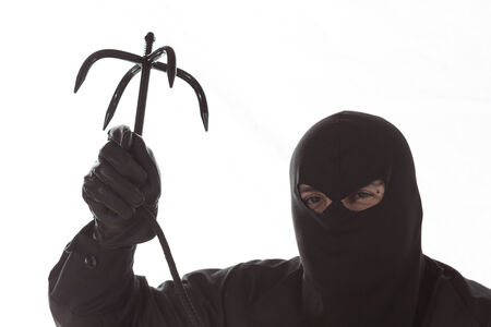 trespasser: Thief with a hook to climb walls Stock Photo
