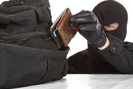 trespasser: Thief stealing a wallet and a bag on a white background