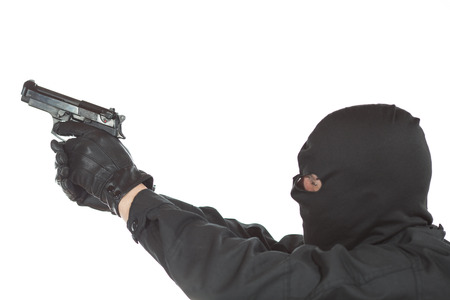 trespasser: Thief holding a gun on white background