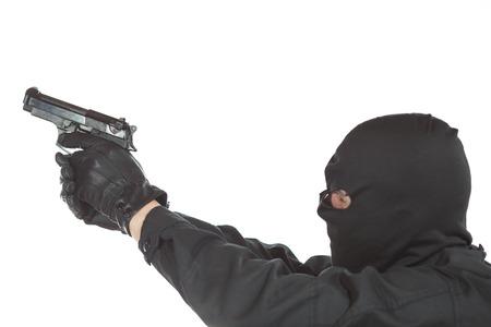 felonious: Thief holding a gun on white background