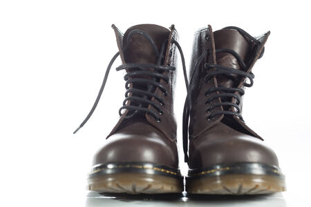Boots made of leather on white background photo