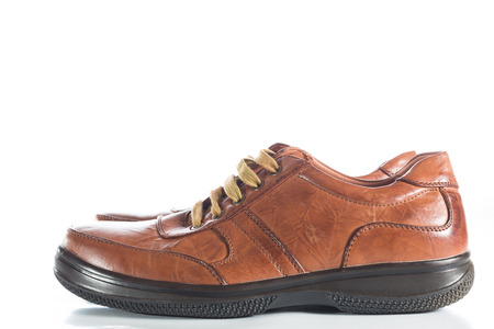 elaborate: Brown leather shoes on a white background