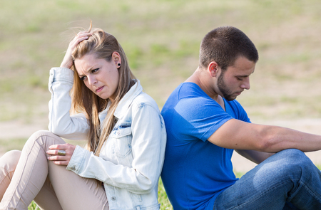 divorcing: Couple sitting back with problems boyfriends Stock Photo