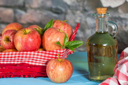 Homemade Vinegar galas apples on a table in a farmhouse Stock Photo