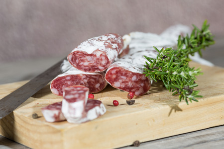 longaniza: Salami sausage with homemade pepper on a cutting board Stock Photo