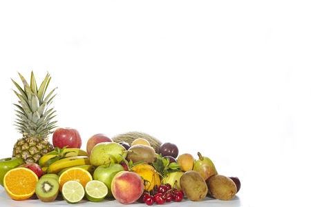 Delicious and healthy fresh fruit on a white background photo