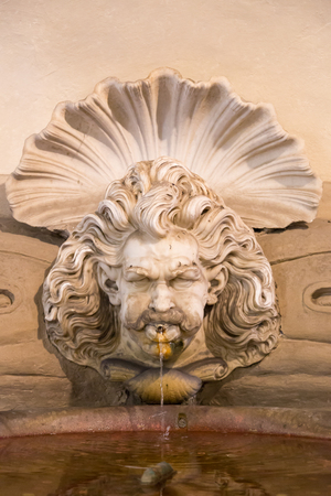 Old public fountain in the province of Florence Italy photo