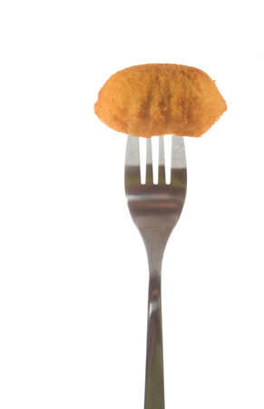 Delicious homemade croquette pricked on a fork on white background photo