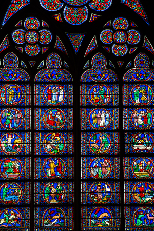 stained glass panel: LUXEMBOURG - MARCH 13: Beautiful Stanied glass window. This religious simbology is from the Notre-Damme Cathedral of Luxembourg. March, 13 2015 Luxembourg Editorial
