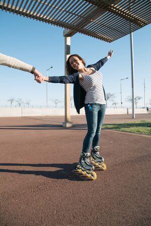 Girls skating and enjoying a spring afternoon photo