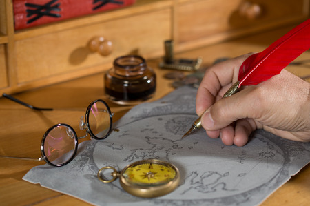 adventurer: Adventurer drawing a map in search of a lost treasure