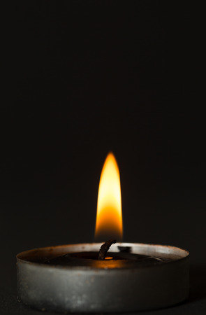 dolor: Black candle with black background