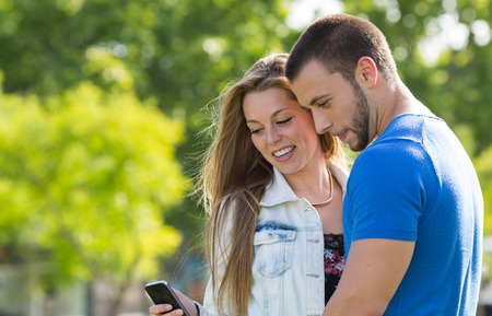 Couple weds at messages in your mobile phone photo