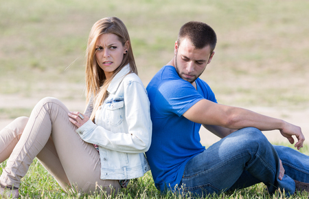 disagreeing: Couple sitting back with problems boyfriends Stock Photo