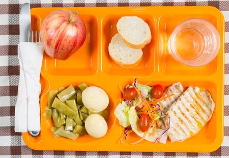 Tray of food in a school canteen Standard-Bild
