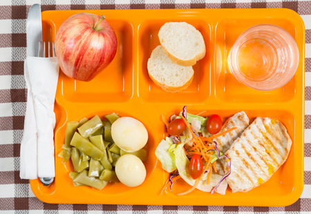 Tray of food in a school canteen Stock Photo