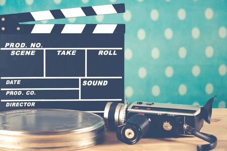 filming: Clapperboard with his camera and tape virgin