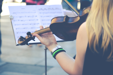 melodies: Female violinist playing in the street nice melodies