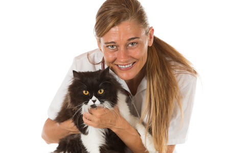 reassuring: Veterinary hugging a cat and reassuring for review