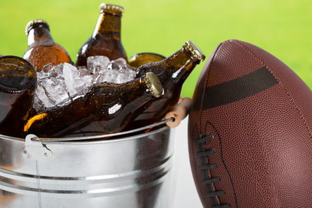 beer bucket: American football with a cold beer in a bucket