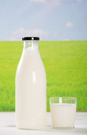 milk bottle: Breakfast with fresh milk by the field