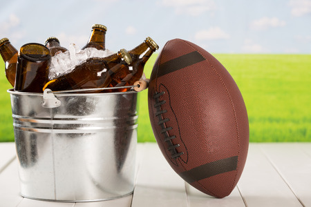 sports bar: American football with a cold beer in a bucket