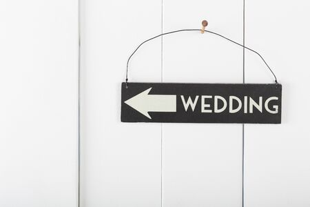 hobnail: Wedding sign hanging on a wooden wall pointing the direction wedding