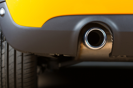 stopped: Sport exhaust in a car stopped orange