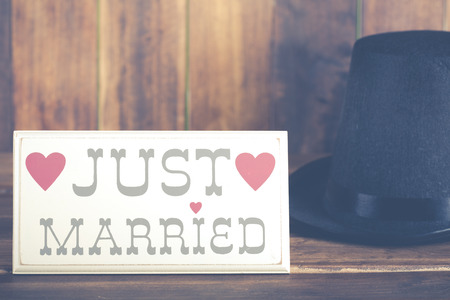 just: Poster newlyweds with a top hat Groom Stock Photo