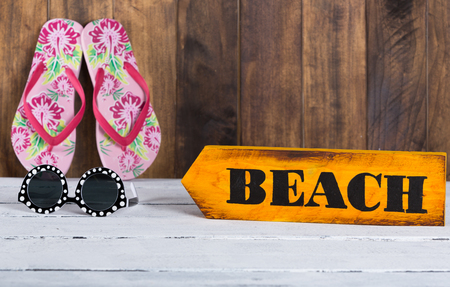 beach access: Direction sign with beach handmade and painted Stock Photo