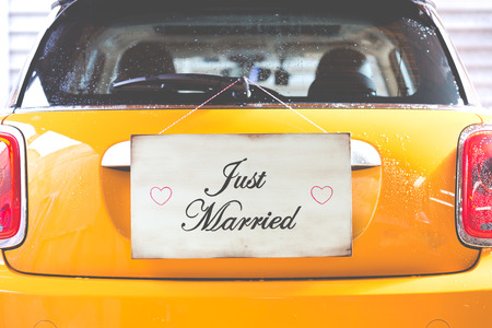 chorme: Just Married poster hanging on a wooden wall Stock Photo