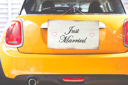 just married: Just Married poster hanging on a wooden wall Foto de archivo