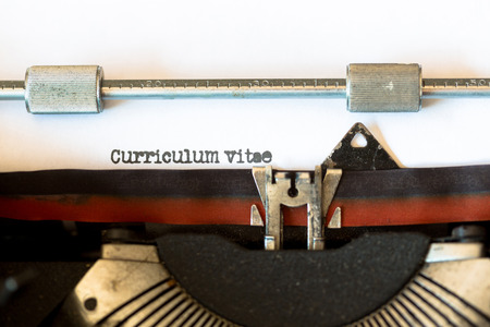 black secretary: Vintage typewriter with a text that says resume Stock Photo