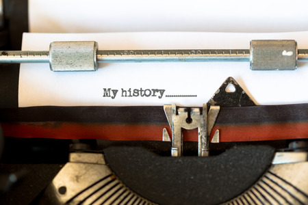 black secretary: Vintage typewriter with a text that says my history