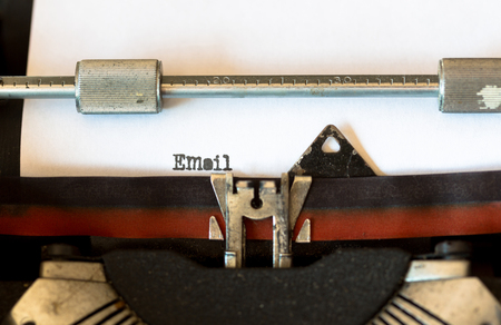 black secretary: Vintage typewriter with a text that says email