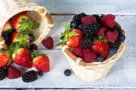 collected: Delicious fruit and wild strawberries collected in a basket