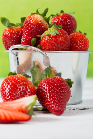 fucking: Fucking freshly strawberries in a metal bucket