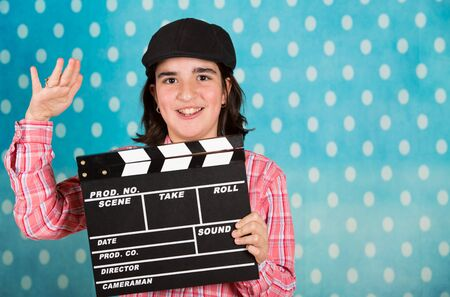 film director: Teen girl with a clapperboard film playing the film director Stock Photo