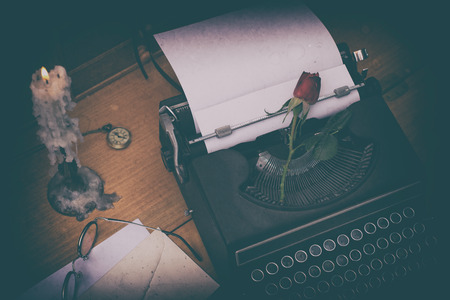 typewrite: Antique typewriter on a desk and a candle