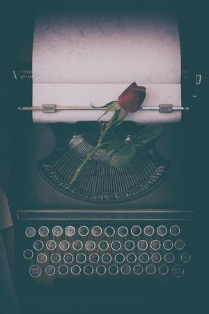 Antique typewriter on a desk and a candle Reklamní fotografie
