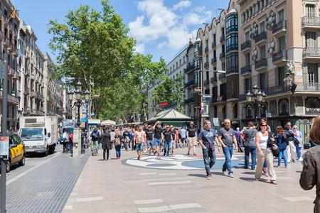 rambla: BARCELONA, SPAIN-MAY 13, 2016: Barcelona is the capital of the autonomous community of Catalonia in Spain city. Crowd of people visit the Rambla de Barcelona, Spain. Editorial